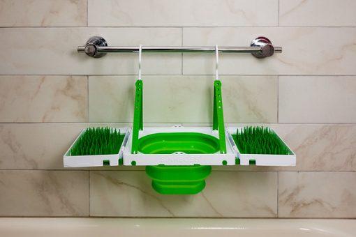 Sinkboss hanging in bathtub drying rack